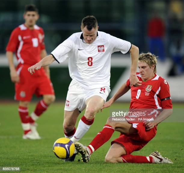 Wales' David Edwards in action with Poland's Jacek Krzynowek during the International Friendly at the Vila Real De Santo Antonio Sports Complex...