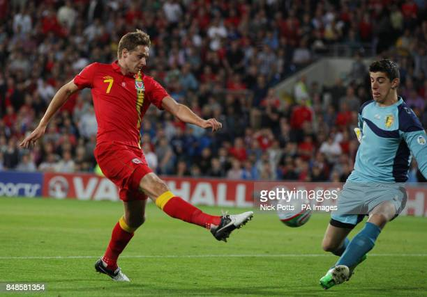 Wales' David Edwards shoots at goal Belgium goalkeeper Thibaut Courtois during the 2014 Fifa World Cup Qualifying match at the Cardiff City Stadium...