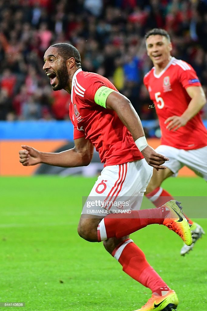 Wales' defender Ashley Williams celebrates after scoring a goal during the Euro 2016 quarter-final football match between Wales and Belgium at the Pierre-Mauroy stadium in Villeneuve-d'Ascq near Lille, on July 1, 2016. / AFP / EMMANUEL