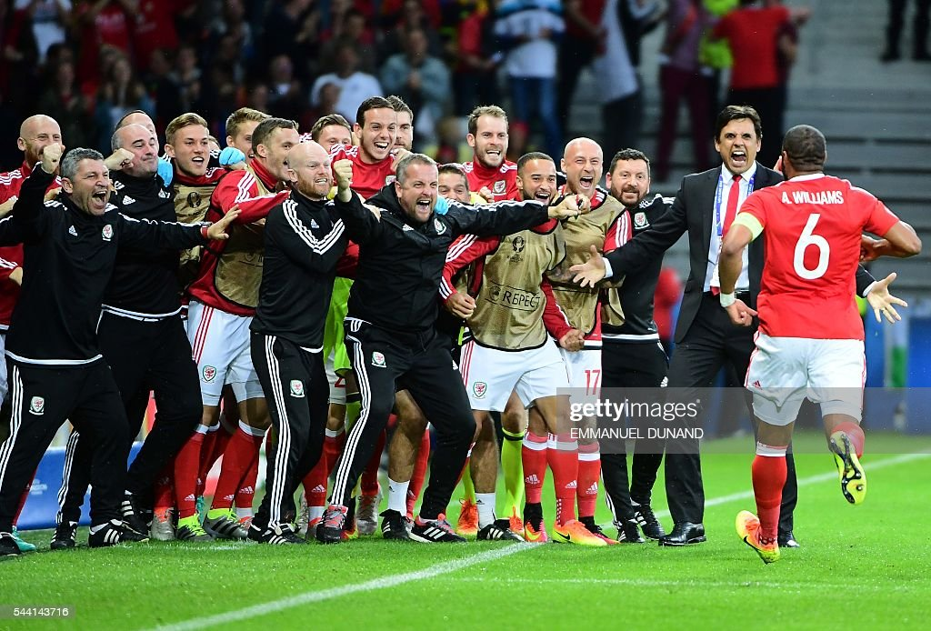 Wales' defender Ashley Williams (R) celebrates after scoring a goal with team members during the Euro 2016 quarter-final football match between Wales and Belgium at the Pierre-Mauroy stadium in Villeneuve-d'Ascq near Lille, on July 1, 2016. / AFP / EMMANUEL