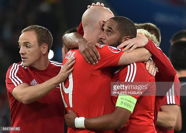 Wales' defender Ashley Williams celebrates with Wales' defender James Collins at the end of the Euro 2016 quarterfinal football match between Wales...