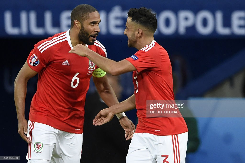 Wales' defender Ashley Williams (L) celebrates with Wales' defender Neil Taylor after scoring a goal during the Euro 2016 quarter-final football match between Wales and Belgium at the Pierre-Mauroy stadium in Villeneuve-d'Ascq near Lille, on July 1, 2016. / AFP / MIGUEL