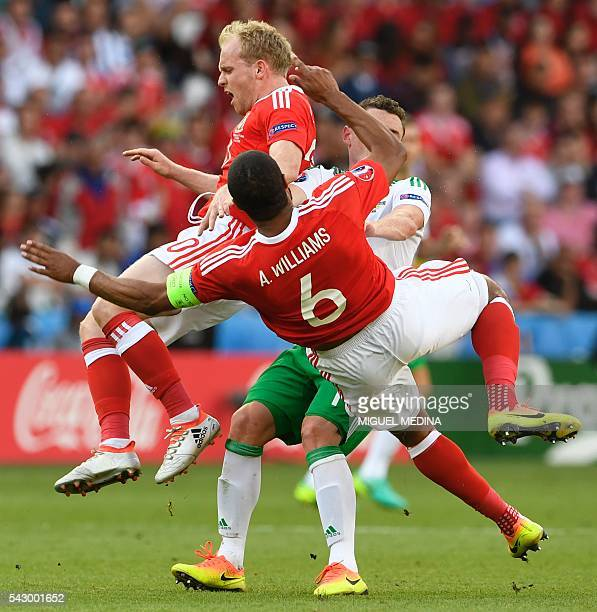Wales' defender Ashley Williams collides with Wales' midfielder Jonathan Williams during the Euro 2016 round of sixteen football match Wales vs...