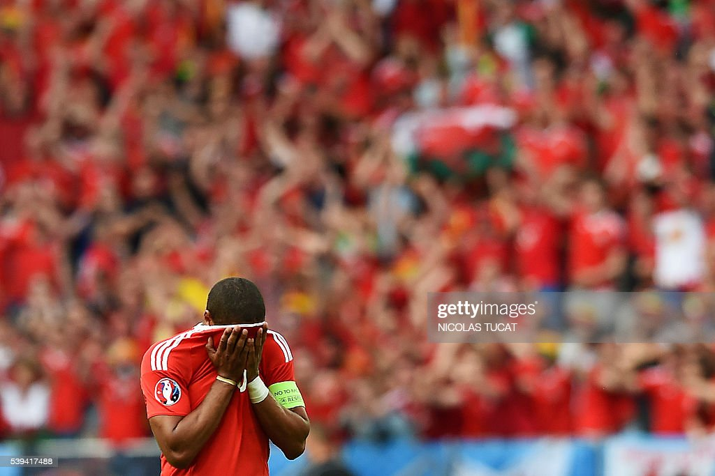 TOPSHOT Wales' defender Ashley Williams reacts during the Euro 2016 group B football match between Wales and Slovakia at the Stade de Bordeaux in...