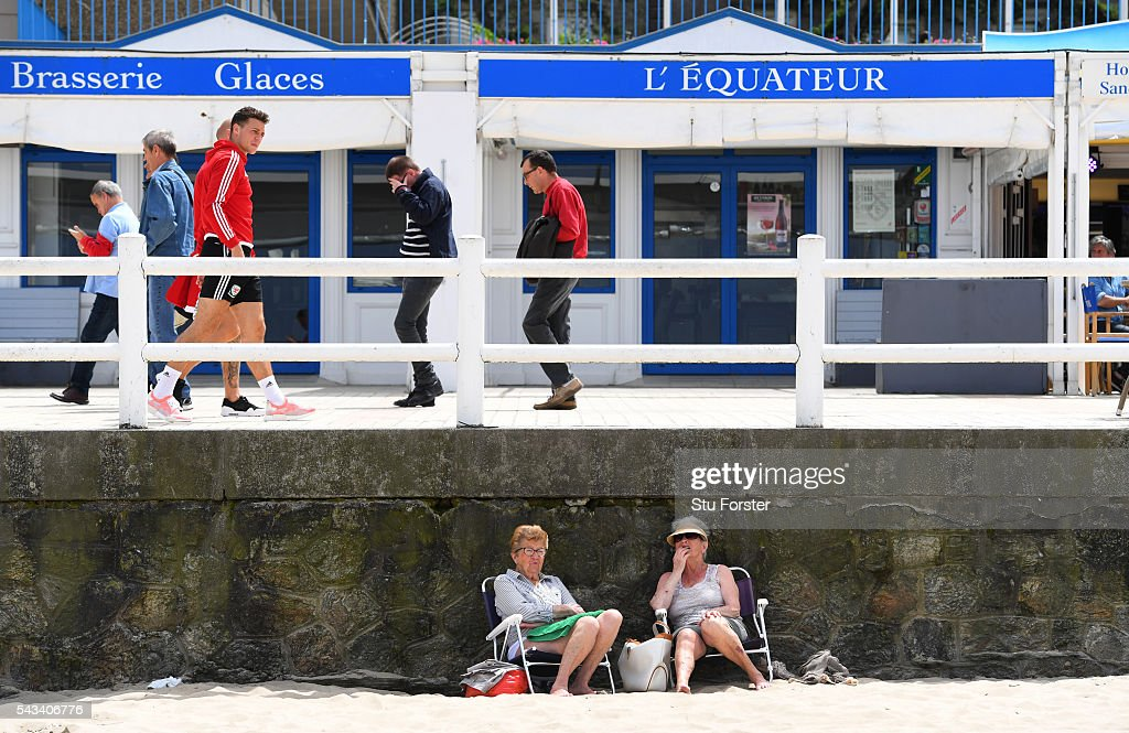 Wales defender <a gi-track='captionPersonalityLinkClicked' href=/galleries/search?phrase=James+Chester&family=editorial&specificpeople=4192570 ng-click='$event.stopPropagation()'>James Chester</a> enjoys a stroll on Dinard beach on June 28, 2016 in Dinard, France.