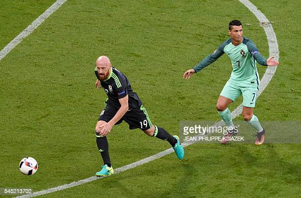 Wales' defender James Collins and Portugal's forward Cristiano Ronaldo vie for the ball during the Euro 2016 semifinal football match between...