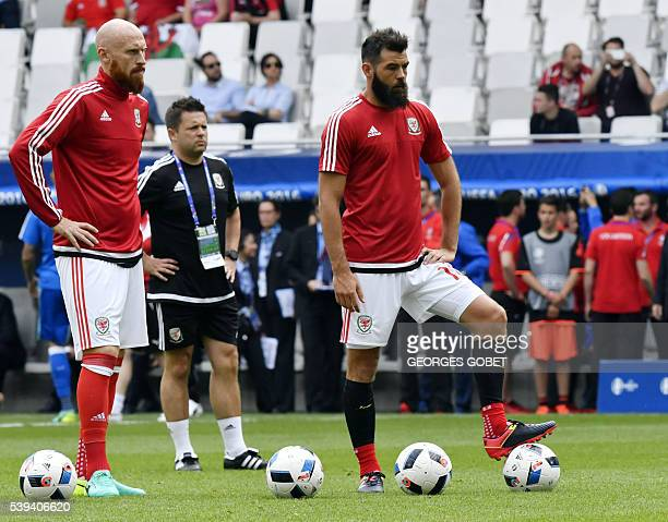 Wales' defender James Collins and Wales' midfielder Joe Ledley warmup prior to the start of the Euro 2016 group B football match between Wales and...