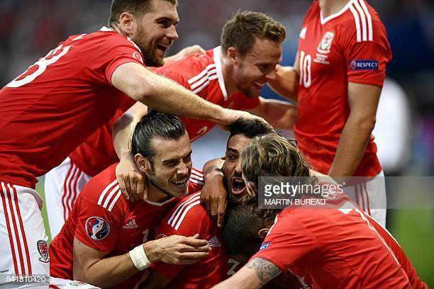 TOPSHOT Wales' defender Neil Taylor celebrates his the team's second goal during the Euro 2016 group B football match between Russia and Wales at the...