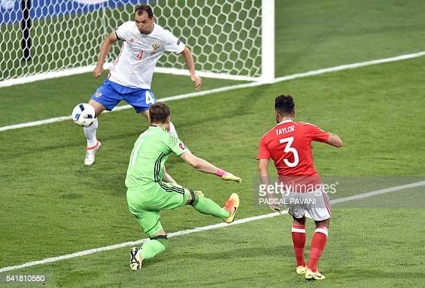 TOPSHOT Wales' defender Neil Taylor scores the team's second goal during the Euro 2016 group B football match between Russia and Wales at the Stadium...