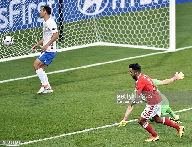 Wales' defender Neil Taylor shoots to score the team's second goal during the Euro 2016 group B football match between Russia and Wales at the...