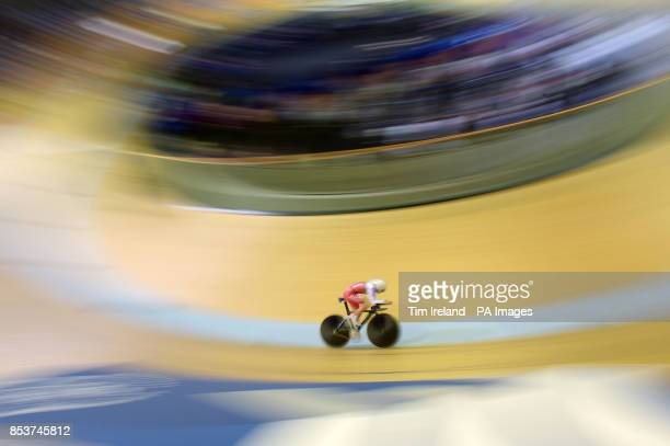 Wales' Elinor Barker rides in the 3000m time trial qualifying at the Sir Chris Hoy Velodrome during the 2014 Commonwealth Games in Glasgow