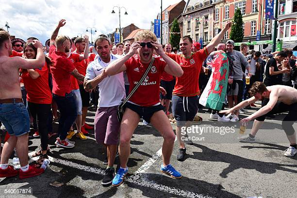 Wales fans celebrate after their team scored during the England v Wales Euro 2016 Group B match on June 16 2016 in Lens France Fans from both...