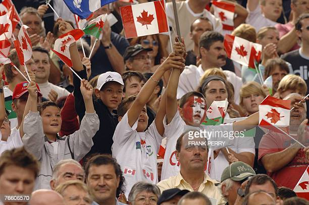 Wales' fans cheer at their team before the rugby union World Cup match Wales versus Canada 09 September 2007 at the Beaujoire stadium in Nantes...