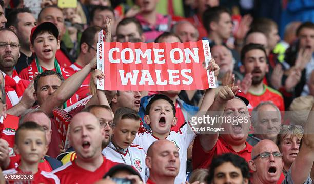 Wales fans shout encourgement to their team during the UEFA EURO 2016 qualifying match between Wales and Belgium at the Cardiff City Stadium on June...