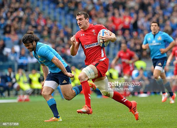 Wales flanker and captain Sam Warburton runs to score a try during the Six Nations international rugby union match between Italy and Wales on March...