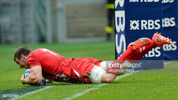 Wales flanker and captain Sam Warburton scores a try during the Six Nations international rugby union match between Italy and Wales on March 21 2015...