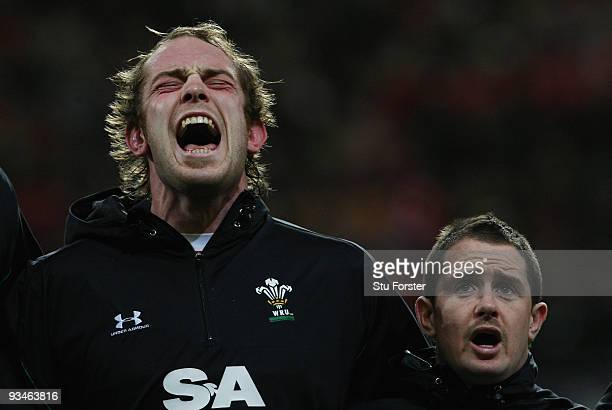 Wales forward AlunWyn Jones sings the national anthem as winger Shane Williams joins in before the Invesco Perpetual match between Wales and...