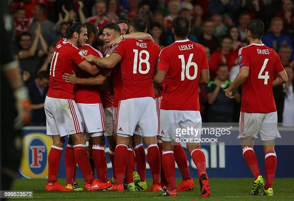 Wales' forward Gareth Bale and Wales's striker Sam Vokes congratulate Wales's midfielder Joe Allen after he scored the team's second goal during the...