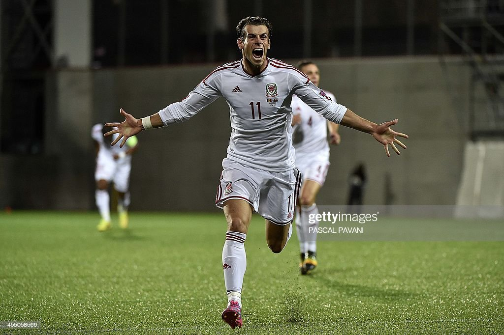 Wales forward Gareth Bale celebrates after scoring a goal during the Euro 2016 qualifying round football match Andorra vs Wales on September 9 2014...