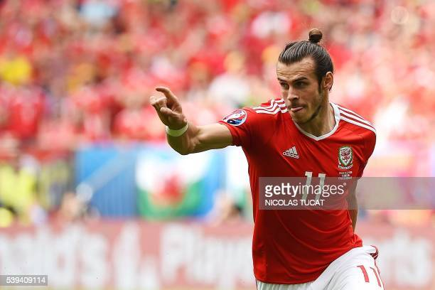 TOPSHOT Wales' forward Gareth Bale celebrates after scoring the first goal during the Euro 2016 group B football match between Wales and Slovakia at...