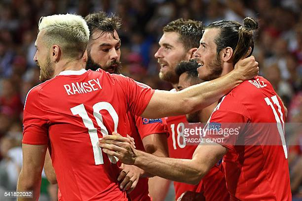 TOPSHOT Wales' forward Gareth Bale celebrates scoring the team's third goal during the Euro 2016 group B football match between Russia and Wales at...
