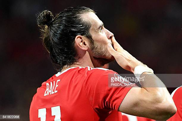 Wales' forward Gareth Bale celebrates scoring the team's third goal during the Euro 2016 group B football match between Russia and Wales at the...