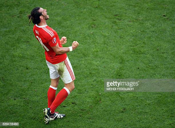 TOPSHOT Wales' forward Gareth Bale celebrates the team's 21 win over Slovakia in the Euro 2016 group B football match between Wales and Slovakia at...