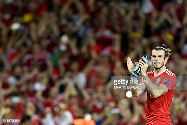 Wales' forward Gareth Bale celebrates their 30 win in the Euro 2016 group B football match between Russia and Wales at the Stadium Municipal in...