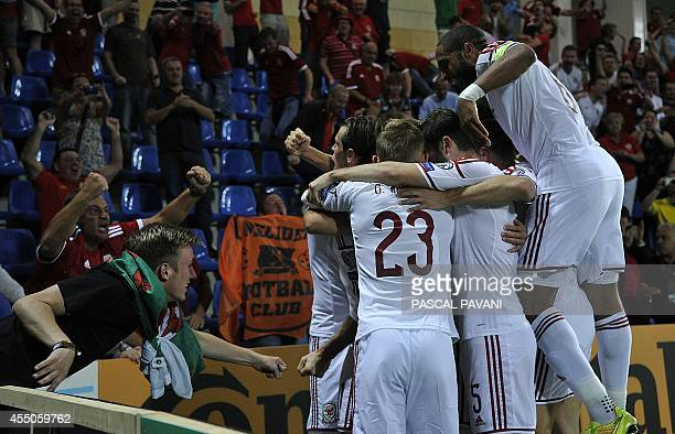 Wales forward Gareth Bale celebrates with teammates and fans after scoring a goal during the Euro 2016 qualifying round football match Andorra vs...