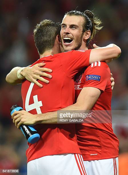 Wales' forward Gareth Bale celebrates with Wales' defender Ben Davies the team's 30 win in the Euro 2016 group B football match between Russia and...
