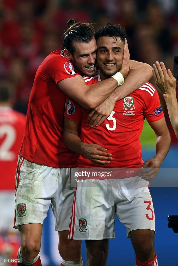 Wales' forward Gareth Bale (L) celebrates with Wales' defender Neil Taylor after the Euro 2016 quarter-final football match between Wales and Belgium at the Pierre-Mauroy stadium in Villeneuve-d'Ascq near Lille, on July 1, 2016. Wales won the match 3-1. / AFP / PAUL