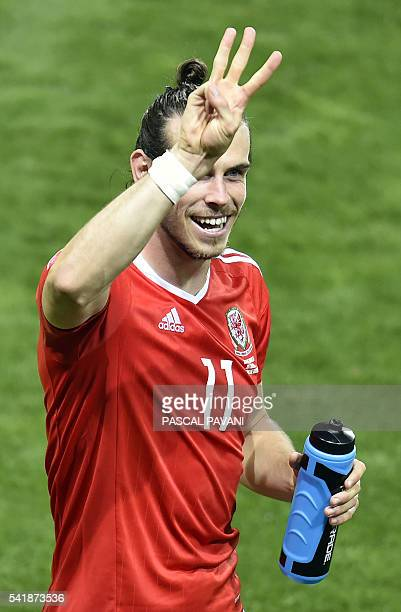 TOPSHOT Wales' forward Gareth Bale indicates the team's 30 win in the Euro 2016 group B football match between Russia and Wales at the Stadium...