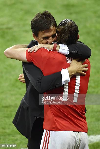 Wales' forward Gareth Bale is congratulated byWales' coach Chris Coleman following the team's 30 win in the Euro 2016 group B football match between...