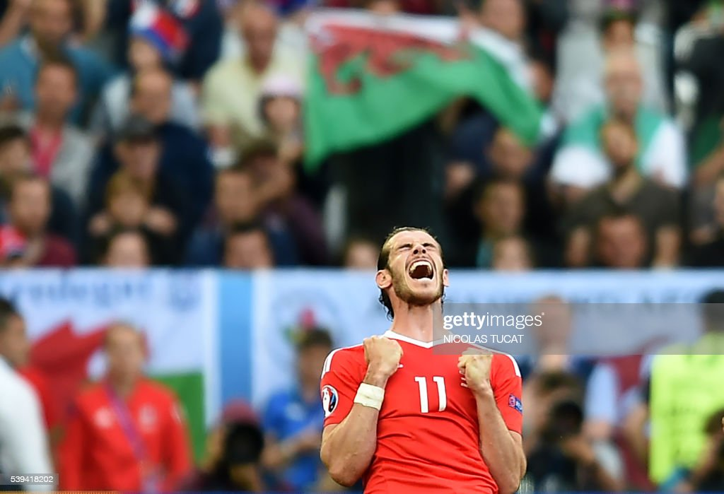 Wales' forward <a gi-track='captionPersonalityLinkClicked' href=/galleries/search?phrase=Gareth+Bale&family=editorial&specificpeople=609290 ng-click='$event.stopPropagation()'>Gareth Bale</a> reacts as Wales wins the Euro 2016 group B football match between Wales and Slovakia at the Stade de Bordeaux in Bordeaux on June 11, 2016. / AFP / NICOLAS