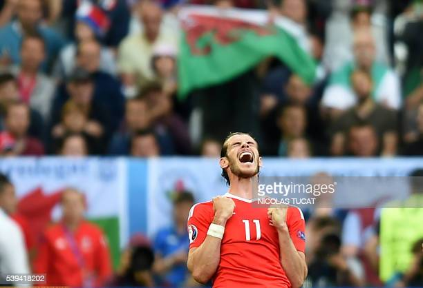 Wales' forward Gareth Bale reacts as Wales wins the Euro 2016 group B football match between Wales and Slovakia at the Stade de Bordeaux in Bordeaux...