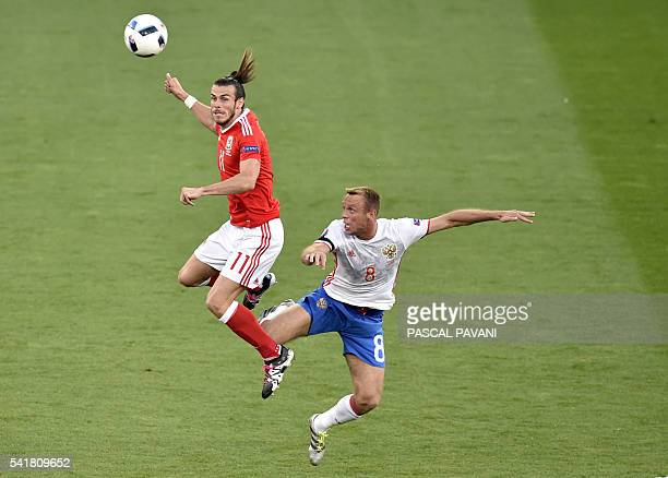 Wales' forward Gareth Bale vies for the ball against Russia's midfielder Denis Glushakov during the Euro 2016 group B football match between Russia...