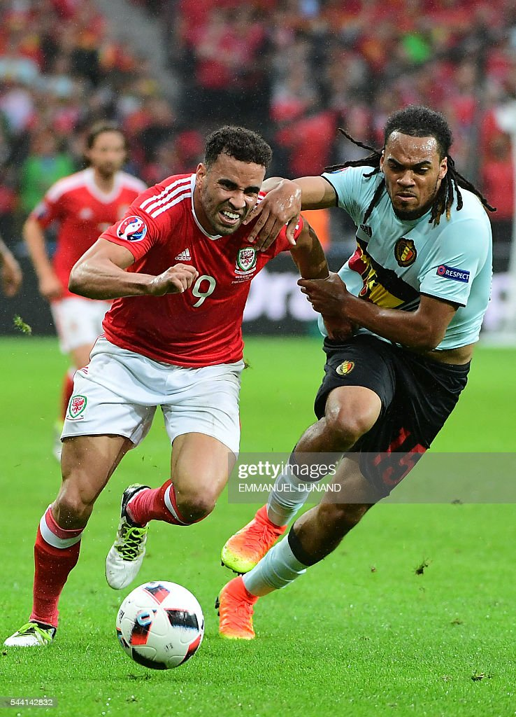 Wales' forward Hal Robson-Kanu and Belgium's defender Jason Denayer vie for the ball during the Euro 2016 quarter-final football match between Wales and Belgium at the Pierre-Mauroy stadium in Villeneuve-d'Ascq near Lille, on July 1, 2016. / AFP / EMMANUEL