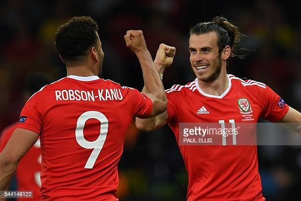 TOPSHOT Wales' forward Hal RobsonKanu celebrates after scoring a goal with Wales' forward Gareth Bale during the Euro 2016 quarterfinal football...