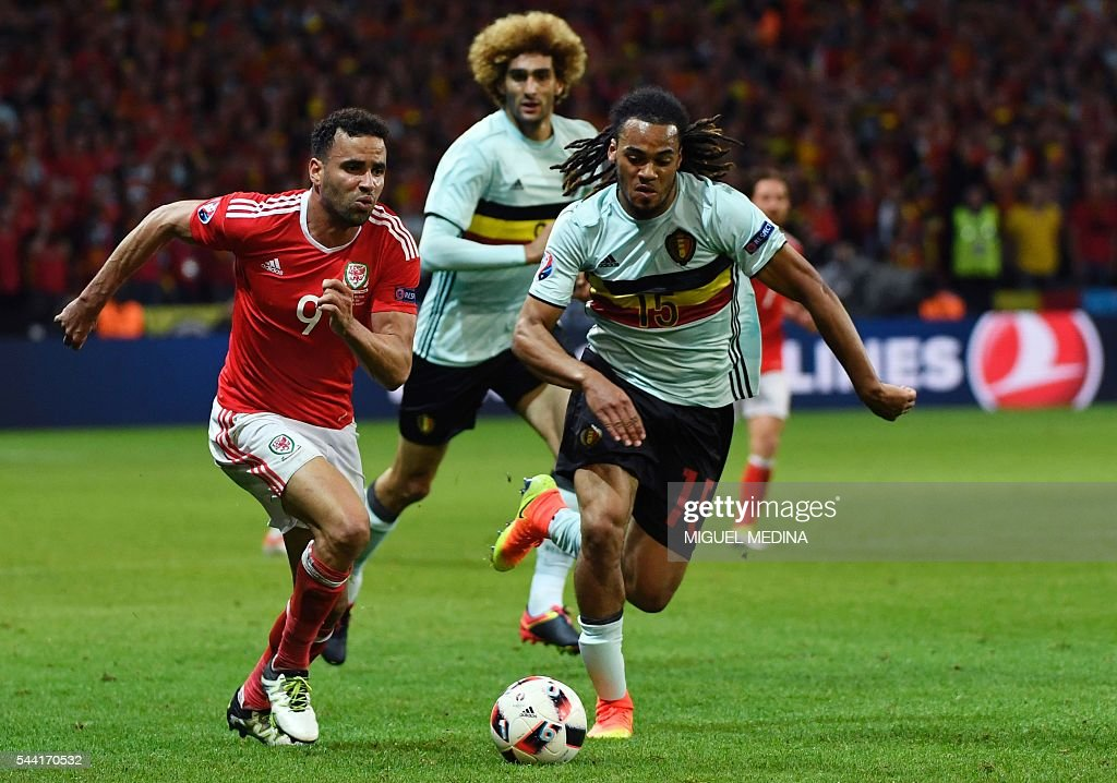 Wales' forward Hal Robson-Kanu (L) challenges Belgium's defender Jason Denayer during the Euro 2016 quarter-final football match between Wales and Belgium at the Pierre-Mauroy stadium in Villeneuve-d'Ascq near Lille, on July 1, 2016. / AFP / MIGUEL