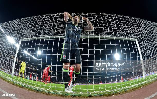 TOPSHOT Wales' forward Sam Vokes reacts during the FIFA World Cup 2018 qualification football match between Serbia and Wales in Belgrade on on June...