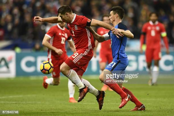 Wales' forward Sam Vokes vies for the ball with France's defender Laurent Koscielny during the friendly football match between France and Wales at...