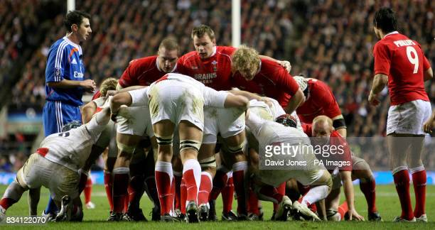 Wales front row prepare to pack down against the England line during the RBS 6 Nations match at Twickenham London