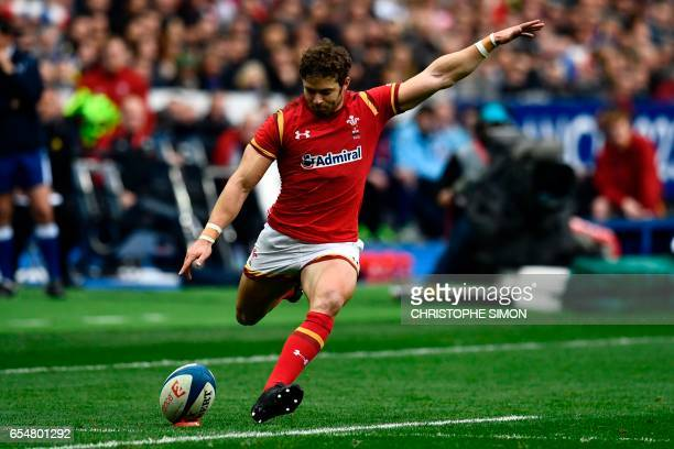 Wales' fullback Leigh Halfpenny kicks the ball during the Six Nations tournament Rugby Union match between France and Wales at the Stade de France in...