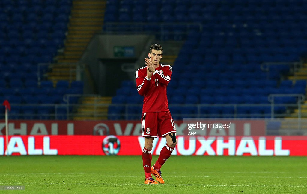 Wales' Gareth Bale acknowledges the fans at the end of the international friendly football match between Wales and Finland at Cardiff City Stadium in Cardiff, south Wales on November 16, 2013. The match ended 1-1.