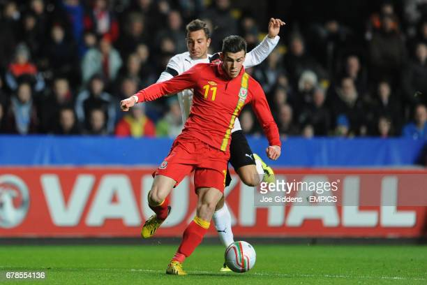 Wales' Gareth Bale and Austria's Markus Suttner battle for the ball