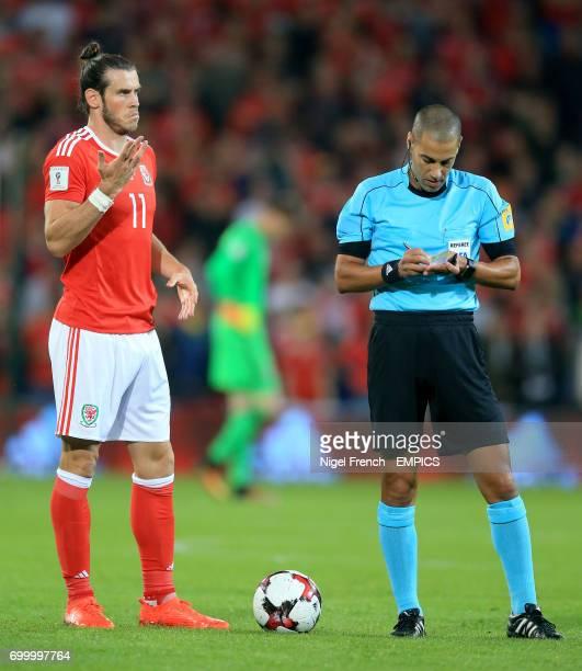 Wales' Gareth Bale and match referee Liran Liany