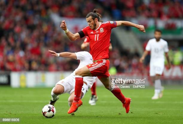 Wales' Gareth Bale in action against Georgia's Murtaz Daushvili
