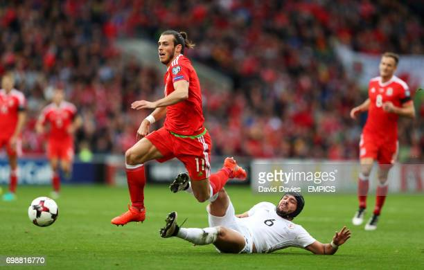 Wales' Gareth Bale in action with Georgia's Murtaz Daushvili