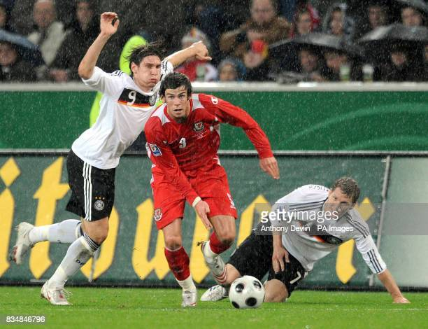 Wales' Gareth Bale in action with Germany's Patrick Helmes and Bastian Schweinsteiger during the FIFA World Cup Qualifying match at Borussia Park...