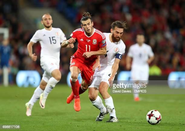 Wales' Gareth Bale is challenged by Georgia's Guram Kashia